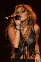 Miley Cyrus : miley_cyrus_1292601419.jpg